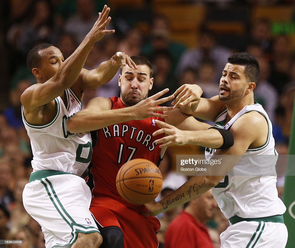 Celtics guard Avery Bradley (#0) and center Vitor Faverani (#38) forced a turnover by intercepting a pass intended for Raptors center Joan Valanciunas (#17) in the second quarter. The Boston Celtics play the Toronto Raptors in the Celtics' first NBA preseason game at TD Garden in Boston, MA on Monday, October 7, 2013. (Yoon S. Byun/Globe Staff) Slug: celtics Reporter: baxter holmes