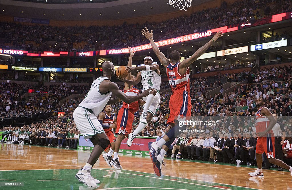 Celtics guard Jason Terry takes it to the hoop, then dishes off to Kevin Garnett for two points as the Boston Celtics hosted the Washington Wizards in a regular season NBA game at the TD Garden.
