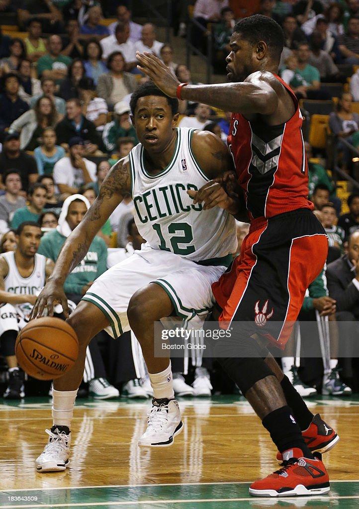 Celtics guard MarShon Brooks (#12) drove baseline against Raptors forward Amir Johnson (#15) in the second quarter. The Boston Celtics play the Toronto Raptors in the Celtics' first NBA preseason game at TD Garden in Boston, MA on Monday, October 7, 2013. (Yoon S. Byun/Globe Staff) Slug: celtics Reporter: baxter holmes
