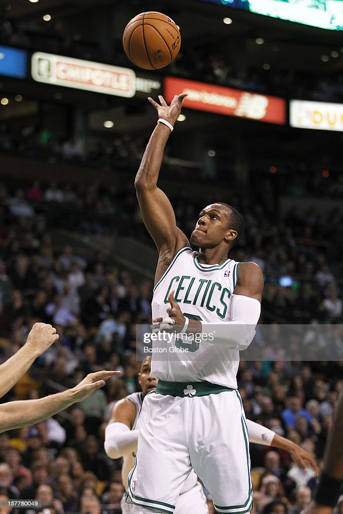 Celtics guard Rajon Rondo (#9) hits a floater in the first quarter as the Boston Celtics play the Minnesota Timberwolves during a regular season NBA game at the TD Garden in Boston, Mass. on Wednesday, Dec. 5, 2012.