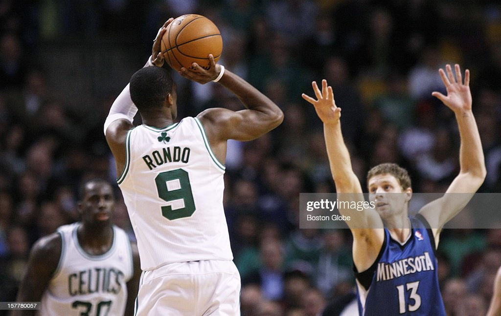 Celtics guard Rajon Rondo (#9) hits a jumper in the third quarter while guarded by Timberwolves guard Luke Ridnour (#13) in the third quarter as the Boston Celtics play the Minnesota Timberwolves during a regular season NBA game at the TD Garden in Boston, Mass. on Wednesday, Dec. 5, 2012.