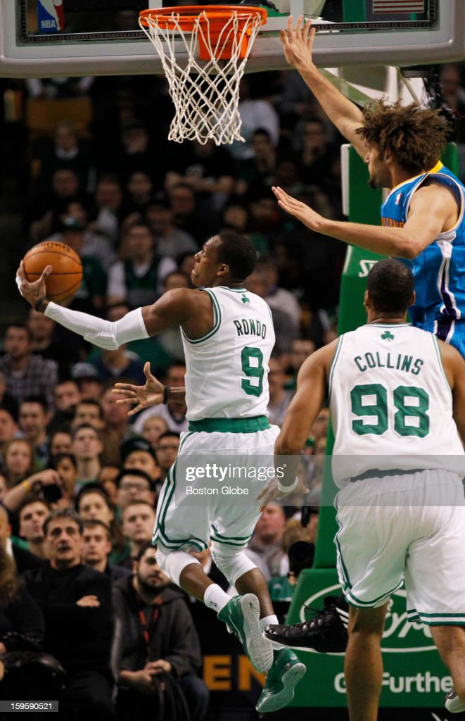 Celtics guard Rajon Rondo (#9) hits a reverse layup in the second quarter as the Boston Celtics play the New Orleans Hornets in a regular season NBA game at TD Garden in Boston, Mass. on Wednesday, Jan. 16, 2013.