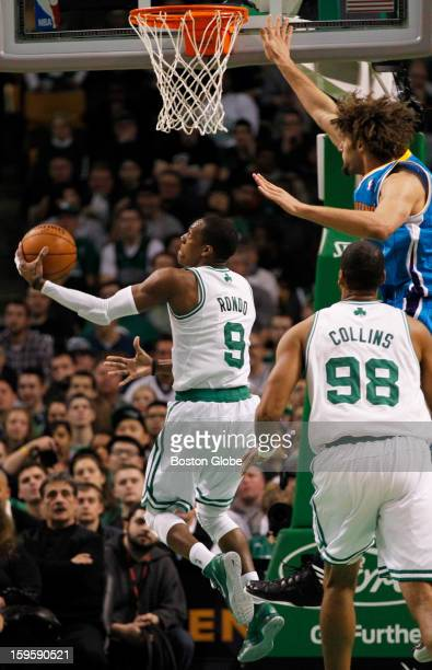 Celtics guard Rajon Rondo hits a reverse layup in the second quarter as the Boston Celtics play the New Orleans Hornets in a regular season NBA game...