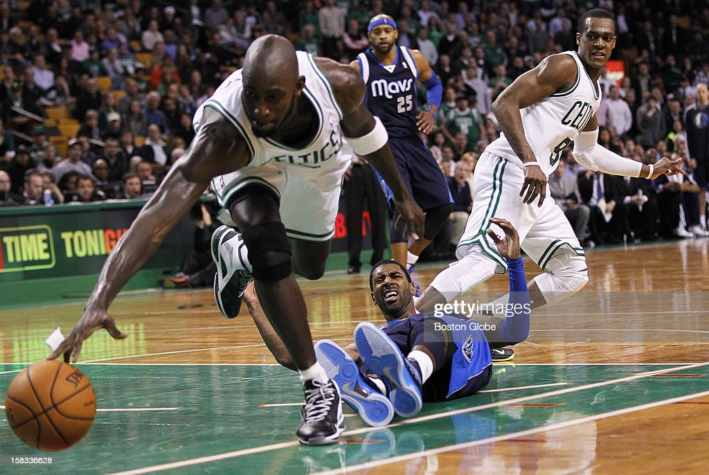 Celtics guard Rajon Rondo (#9) strips Mavericks guard O.J. Mayo (#32) on a drive to the hoop, with forward Kevin Garnett (#5) recovering the ball with a 1:07 left in double overtime as the Boston Celtics play the Dallas Mavericks during a regular season NBA game at TD Garden in Boston, Mass. on Wednesday, December 12, 2012. The Celtics won 117-115.