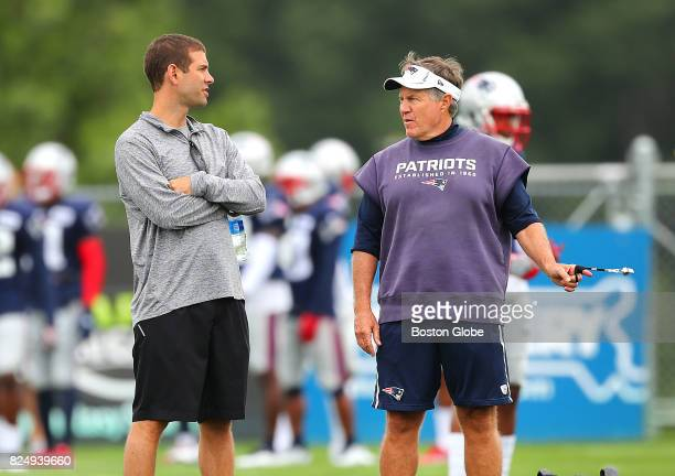 Celtics head coach Brad Stevens left chats with Patriots head coach Bill Belichick right during the third day of training camp at the Gillette...