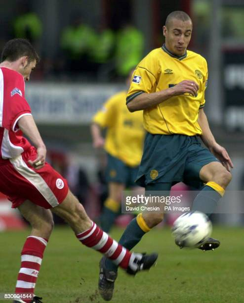Celtic's Henrik Larsson battles for the ball with Aberdeen's Kevin McNaughton during the Scottish Premier League match at Pittodrie Aberdeen