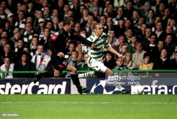 Celtic's Henrik Larsson battles to get past Juventus' Alessandro Birindelli