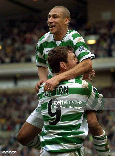 Celtic's Henrik Larsson celebrates his goal against Dundee United with teammate Chris Sutton during their Scottish Cup semifinal football match at...