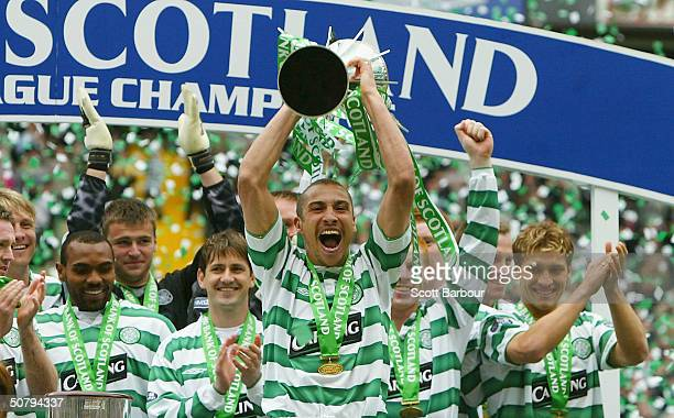 Celtic's Henrik Larsson celebrates with the trophy after the Scottish Premier League match between Glasgow Celtic and Dunfermline Athletic played at...