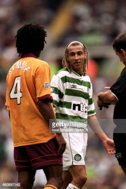 Celtic's Henrik Larsson shrugs his shoulders in innocence at Motherwell's Benito Kemble and Referee Alan Freeland