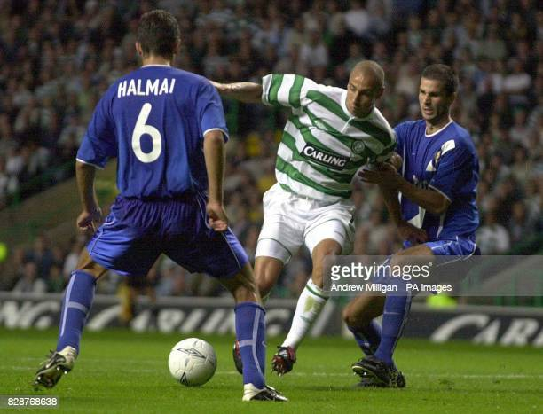 Celtic's Henrik Larsson tries to squeeze the ball past MTK Hungaria's during their Champions League 3rd qualifying round 2nd leg match at Celtic Park...