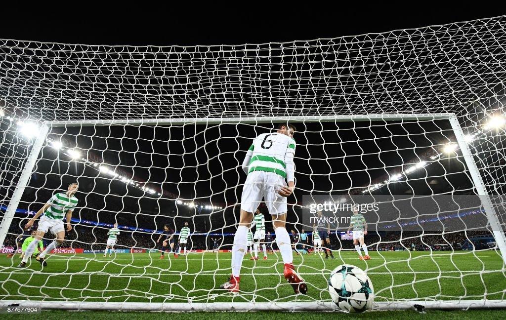 Celtic's Israeli midfielder Nir Bitton (C/#6) reacts with teammates after a Paris Saint-Germain (PSG) goal during the UEFA Champions League Group B football match between Paris Saint-Germain (PSG) and Glasgow Celtic at Parc des Princes Stadium in Paris on November 22, 2017. /