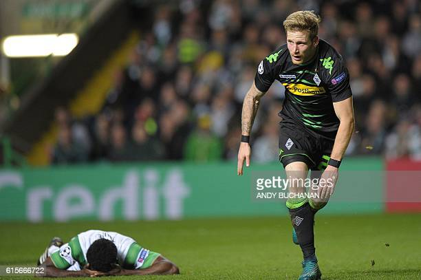 Celtic's Ivorian defender Kolo Toure reacts as Monchengladbach's German midfielder Andre Hahn celebrates scoring his team's second goal during the...