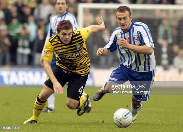 Celtic's James Forrest holds off Kilmarnock's Liam Kelly during the Clydesdale Bank Scottish Premier League match at Rugby Park Kilmarnock