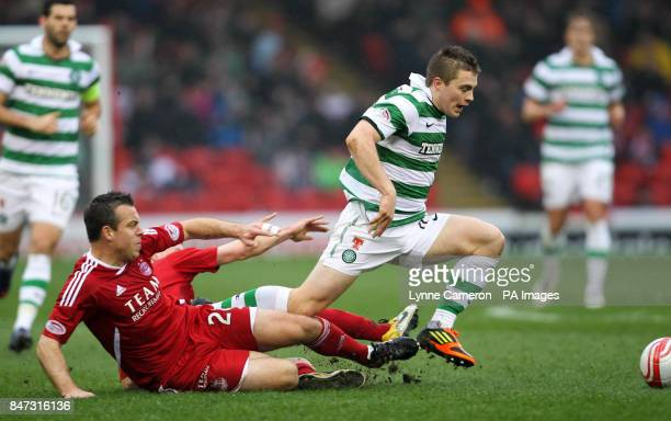 Celtic's James Forrest is tacked by Aberdeen's Gavin Rae during the Clydesdale Bank Scottish Premier League match at Pittodrie Stadium Aberdeen