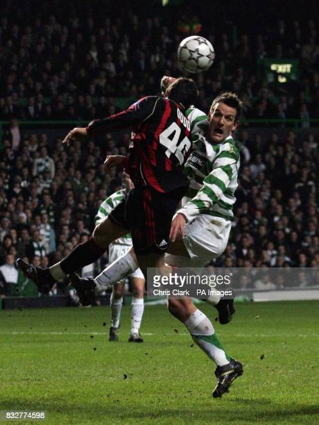 Celtic's Jan Vennegoor of Hesselink jumps for the ball with AC Milan's Massimo Oddo during the Champions League first knockout round first leg match...
