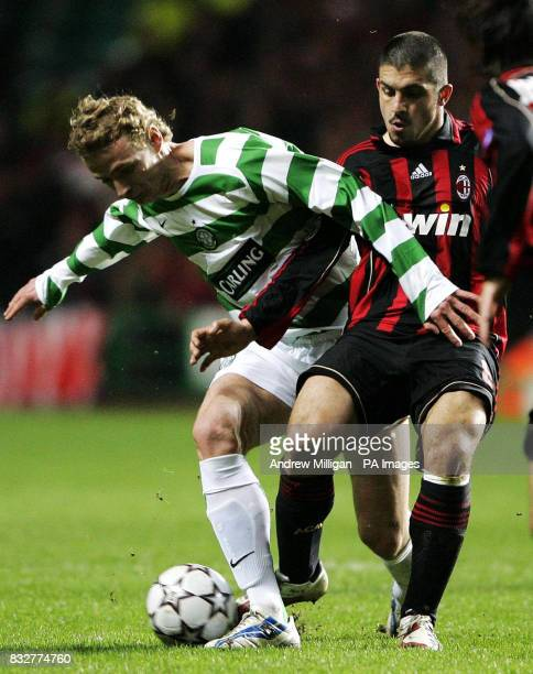Celtic's Jiri Jarosik challenges AC Milan's Rino Gattuso during the Champions League first knockout round first leg match at Celtic Park Glasgow