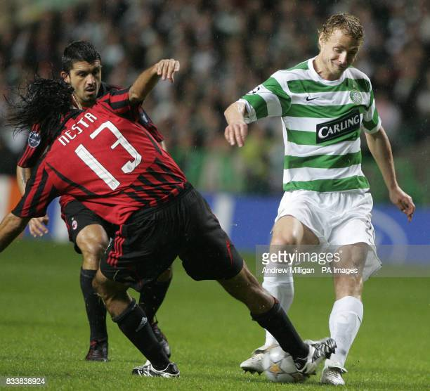 Celtic's Jiri Jarosik is tackled by AC Milan's Alessandro Nesta