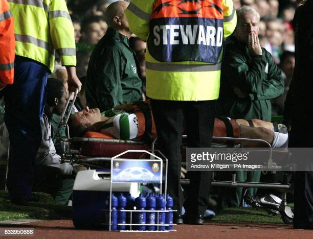 Celtic's John Kennedy is stretchered off during the UEFA Champions League match Celtic Park Glasgow