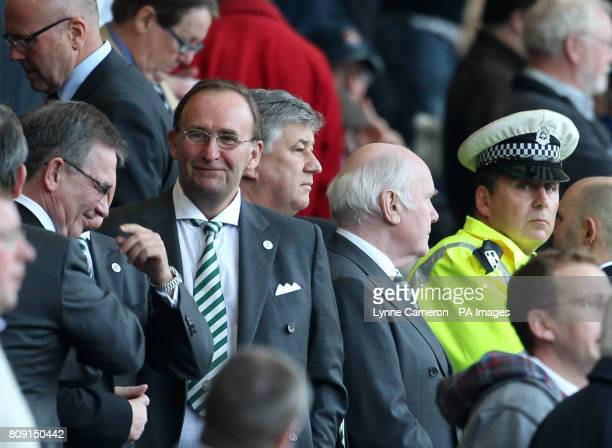 Celtic's John Reid Peter Lawell Eric Riley and Brian Wilson with police in the directors box during the Clydesdale Bank Scottish Premier League match...