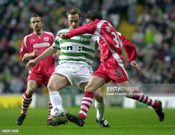 Celtic's Joos Valgaeren battles with Aberdeen's Kevin McNaughton and Arild Stavrum during their Scottish Premier League football match at Celtic Park...