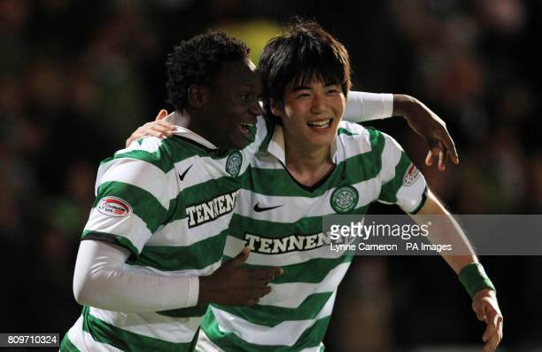Celtic's Ki Sung Yeung celebrates scoring the second goal with Victor Wanyama during the Clydesdale Bank Scottish Premier League match at McDiarmid...