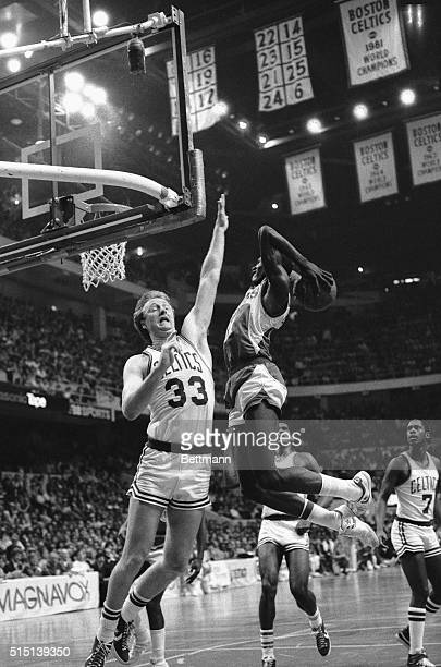 Celtics' Larry Bird attempts to block high flying Atlanta Hawks' Dominique Wilkins who goes up for a slam dunk during 3rd quarter action in game one...