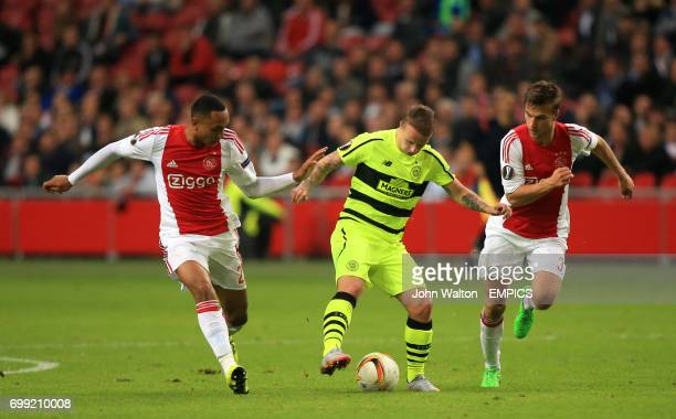 Celtic's Leigh Griffiths battle for the ball with Ajax's Kenny Tete and Joel Veltman