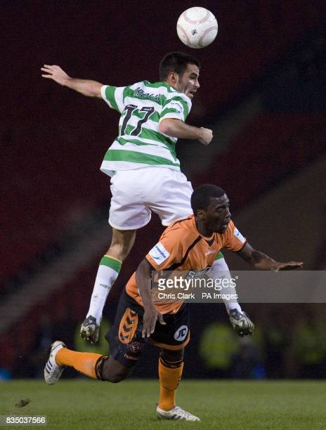 Celtic's Marc Crosas leaps into the back of Dundee United's Morgaro Gomis during the Cooperative Insurance Cup Semi Final match at Hampden Park...