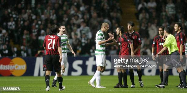 Celtic's Massimo Donati and AC Milan's Gennaro Gattuso argue during the game
