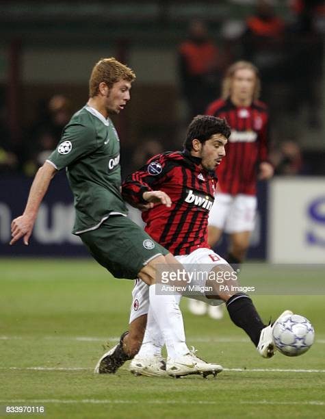 Celtic's Massimo Donati and AC Milan's Gennaro Gattuso battle for the ball during UEFA Champions League match at San Siro
