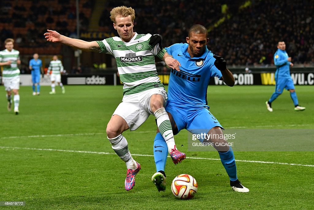 Celtic's midfielder Gary Mackay-Steven (L) vies with Inter Milan's Brazilian defender Juan during the UEFA Europa League round of 32 second leg football match Inter Milan vs Celtic FC on February 26, 2015 at the San Siro Stadium stadium in Milan.