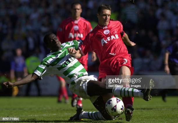 Celtic's Mohammed Sylla and Aberdeen's Derek Whyte fight for the ball in the Bank of Scotland Scottish Premier League at Aberdeen's Pittodrie stadium