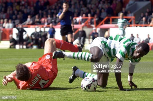 Celtic's Mohammed Sylla and Aberdeen's Philip McGuire take a tumble during the match in the Bank of Scotland Scottish Premier League at Aberdeen's...