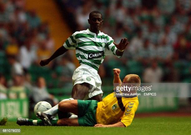 Celtic's Mohammed Sylla gets tackled by Tadad Pepeckys of Kaunas