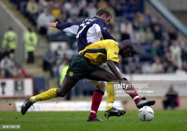 Celtic`s Mohammed Sylla holds off Dundee's Steve Lovell during the Bank of Scotland Scottish Premiership match at Dundee's Dens Park Stadium