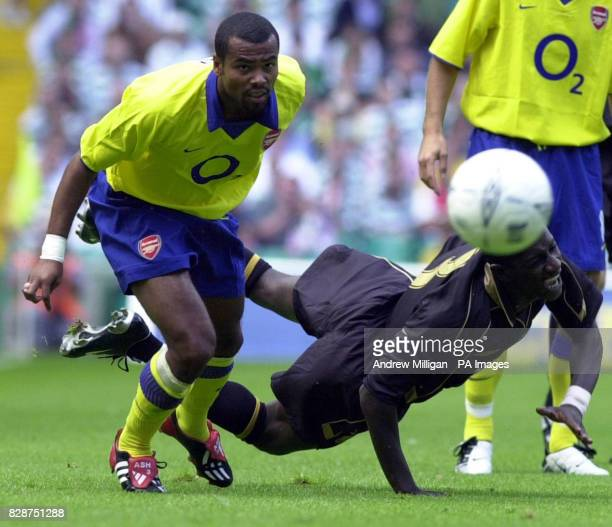 Celtic's Momo Sylla falls after being challenged by Arsenal's Ashley Cole during the preseason friendly between Celtic and Arsenal at Celtic Park...