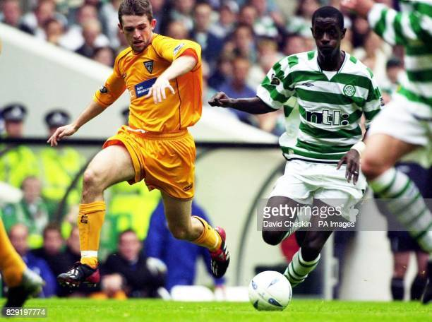 Celtic's Momo Sylla holds off Dunfermline's Andrius Skerla during the first game of the Bank of Scotland Premier League between Celtic and...