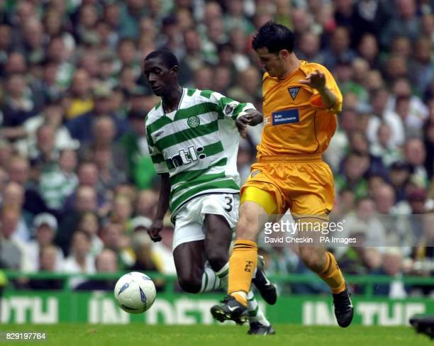 Celtic's Momo Sylla holds off Dunfermline's Stephen Crawford during their Bank of Scotland Premier League match at Celtic Park Glasgow