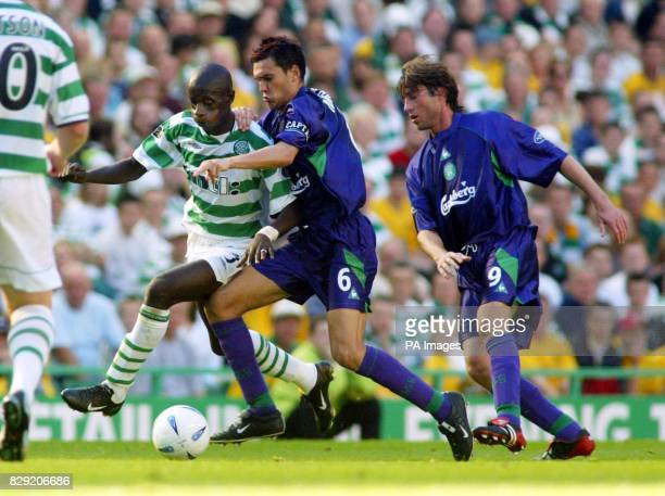 Celtic's Momo Sylla is challenged by Ian Murray with Paco Luna watching on during the Bank of Scotland Scottish Premier League match at Celtic Park...