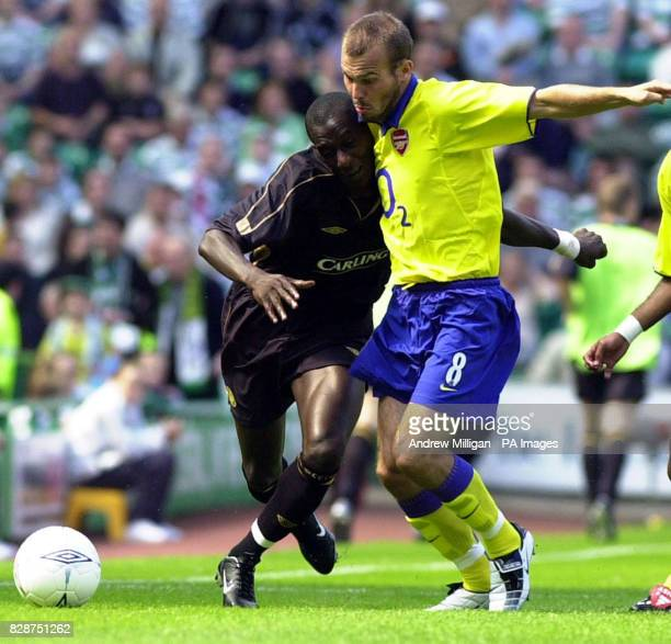 Celtic's Momo Sylla leans into Arsenal's Freddie Ljungberg during the preseason friendly between Celtic and Arsenal at Celtic Park Glasgow THIS...