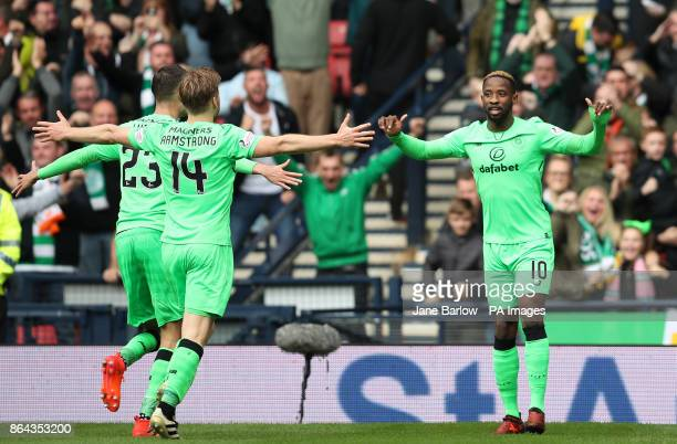 Celtic's Moussa Dembele celebrates scoring his side's third goal of the game with teammates Mikael Lustig and Stuart Armstrong during the Betfred Cup...