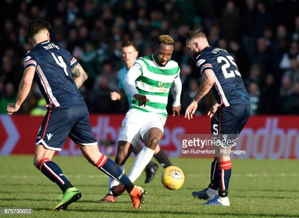 Celtics Moussa Dembele tries to get past Ross Countys Christopher Routis and James OBrien during the Ladbrokes Scottish Premiership match at the...