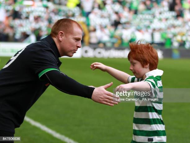 Celtic's Neil Lennon welcomes his son Gallagher off the pitch as he was mascot before the Clydesdale Bank Scottish Premier League match at Celtic...