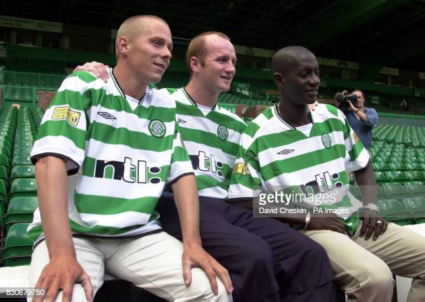 Celtic's new signing John Hartson with team mates Steve Guppy and far right Momo Sylla at Celtic Park for a photocall completing deals to join the...