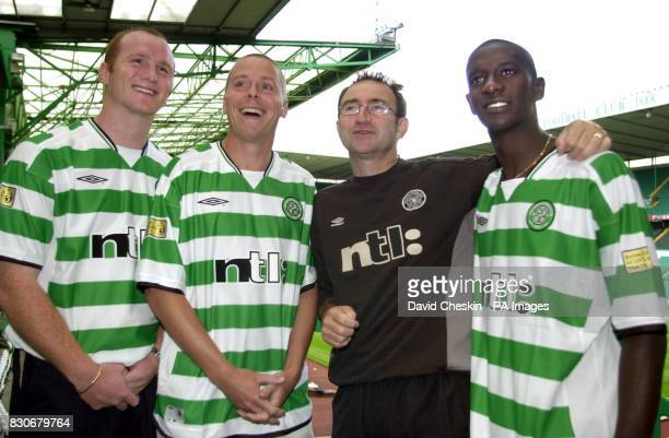 Celtic's new signing John Hartson with team mates Steve Guppy and far right Momo Sylla join manager Martin O`Neill at Celtic Park for a photocall