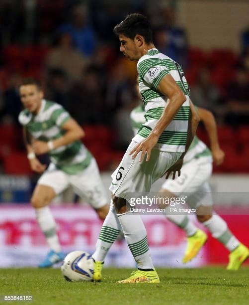 Celtic's Nir Bitton scores a goal from the spot during the Scottish Premier League match at McDiarmid Park Perth