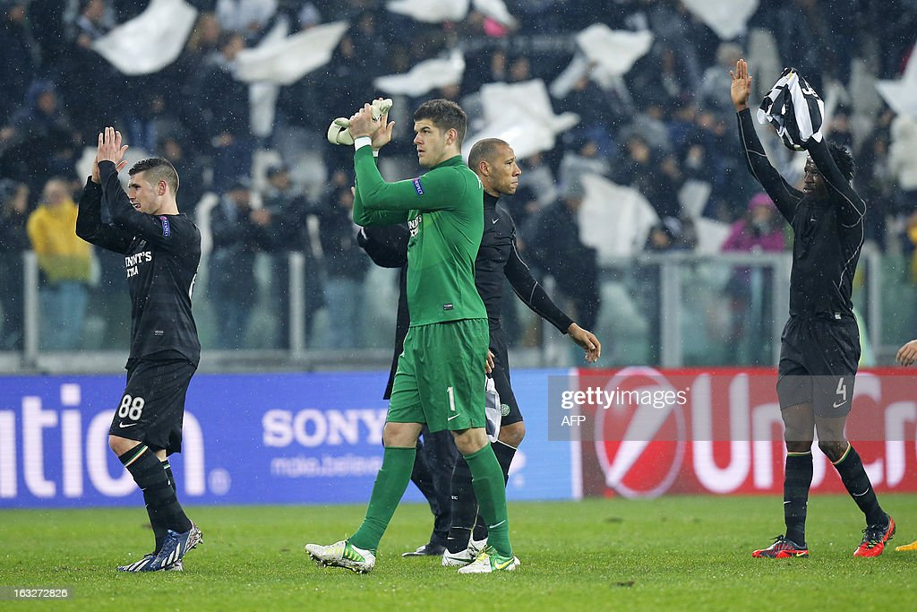 Celtic's players applaud supporters at the end of the Champions League match Juventus vs Celtic FC on March 6, 2013 at the 'Juventus Stadium' in Turin.