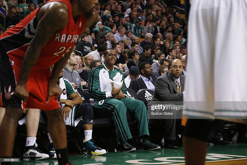 Celtics point guard Rajon Rondo talked to Celtics forward Gerald Wallace (#45) during the game from the bench. He has not played for a year due to a knee injury, and even though he dressed, he did not play. The Boston Celtics played the Toronto Raptors at the TD Garden during a regular season NBA game in Boston, on Wednesday, Jan. 15, 2014.