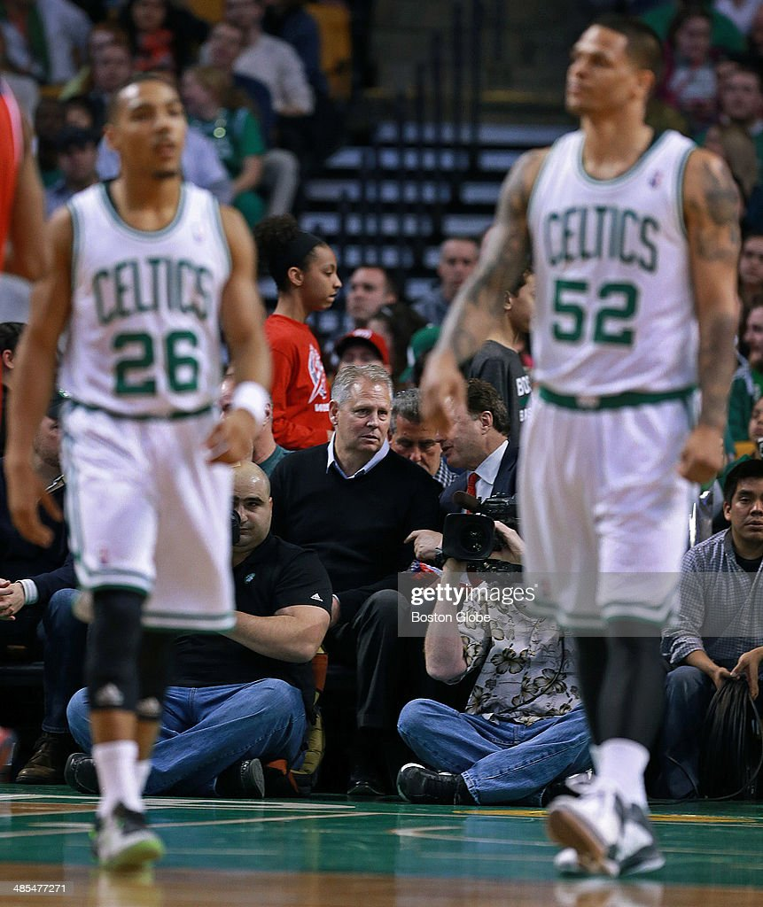 Celtics President and General Manager Danny Ainge watches the action from his seat along the baseline. Boston players Phil Pressey, left, and Chris Babb, right, are also pictured. The Boston Celtics hosted the Washington Wizards in their final NBA game of the season at the TD Garden on Wednesday, April 16, 2014.